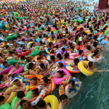 This picture taken on July 27, 2013 shows people trying to cool off at a water park in Suining.
