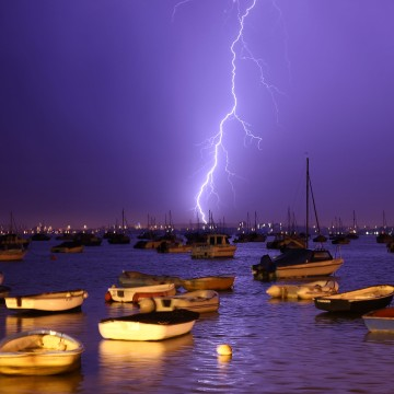 POOLE, ENGLAND - JULY 21:  Lightning strikes over Poole Harbour during a thunderstorm on July 21, 2013 in Poole, England.