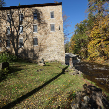 This four-story former mill is set along waterfalls in St. Johnsville, N.Y.