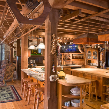 The wood floors of the stone mill, covered with nicks and grooves from former mill workers, were preserved.