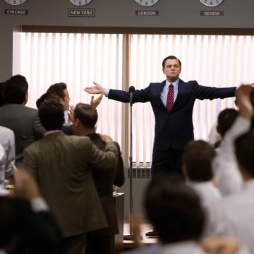 """Leonardo DiCaprio portrays Jordan Belfort in a scene from """"The Wolf of Wall Street,"""" which is laced with profanity. Does swearing have a place at work?"""