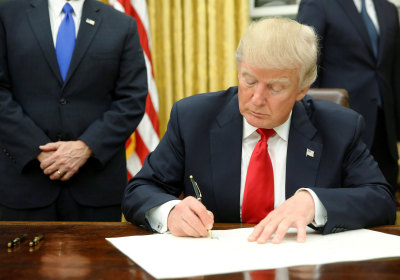 news trump signs first executive order targeting obamacare