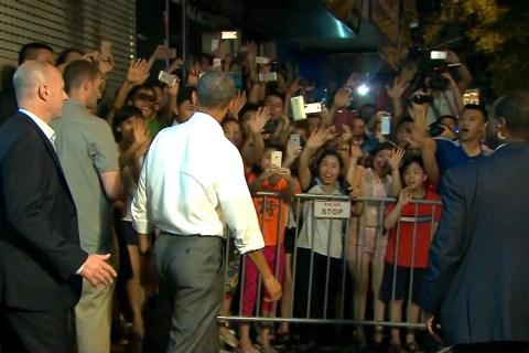 Obama Greets Screaming Fans Outside Hanoi Restaurant
