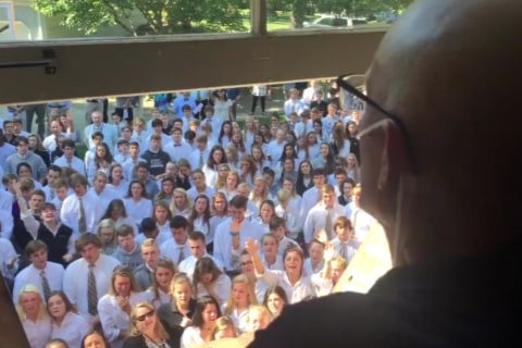 Watch Hundreds of Students Sing to Cancer-Stricken Teacher