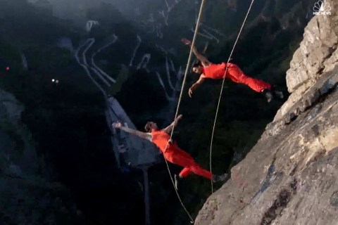 Watch Dancers Perform Suspended from Mountain in China