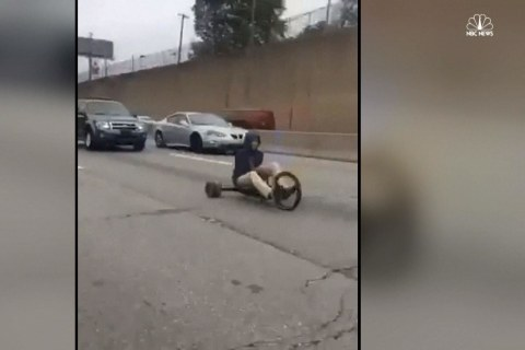 Big Wheel Tricycle Holds Up Traffic on Busy Highway