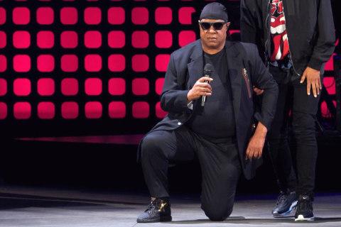 Watch Stevie Wonder Take a Knee for America
