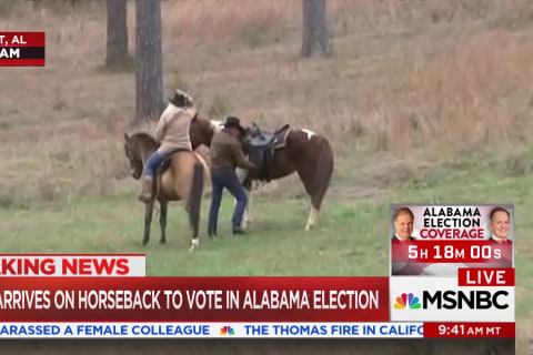 Roy Moore arrives on horseback to vote