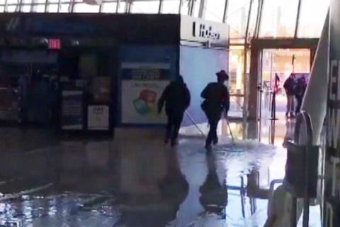 Watch crews clean up flood at JFK International Airport from water main break
