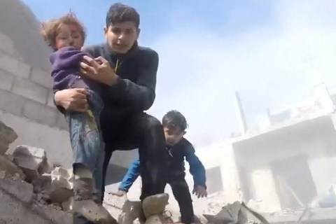 Kids rescued as shelling, airstrikes in Syria kill at least 98 in one day