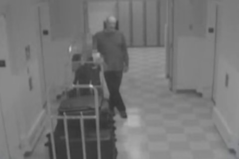 Surveillance video shows Vegas gunman methodically bringing suitcases of weapons to hotel room