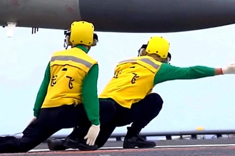 China shows off military muscle as aircraft carrier hosts combat drill