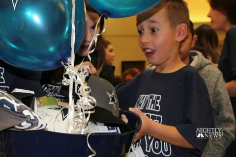 Hundreds gather to celebrate 8-year-old boy's adoption