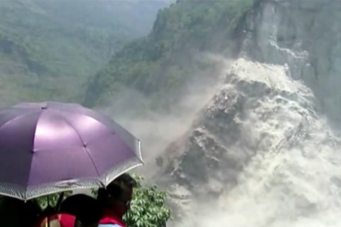 Evacuated Residents in Nepal Watch Massive Landside