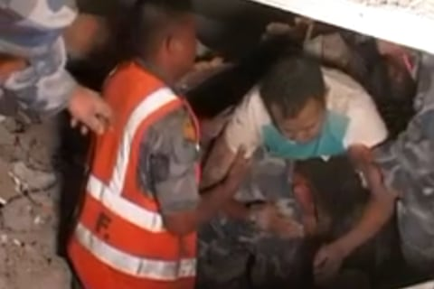 Watch Rescuers Pull Survivors From Nepal Quake Rubble