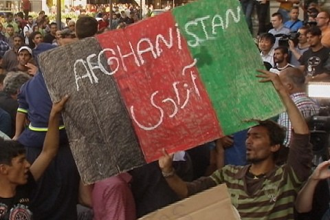 Afghans Gather Around Their Flag Outside Budapest Rail Station