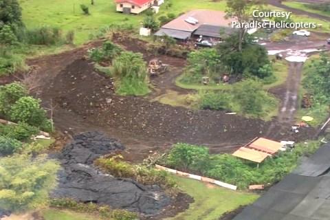 Hawaiians Defend Against Lava Flow's Progress