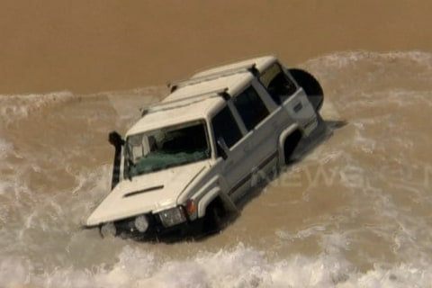WATCH: Police Chase Ends With Car Driving Into Ocean