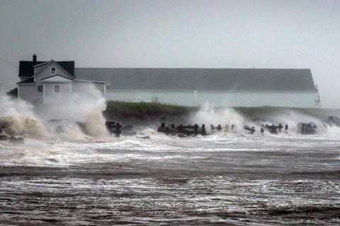 Weakened Arthur Hits Canada as U.S. Cleans Up