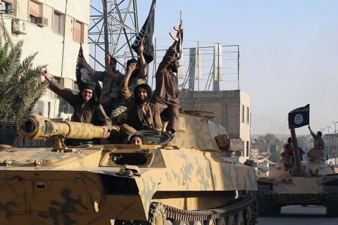 U.S. Airstrikes and Aid for Iraq City Under Siege by ISIS