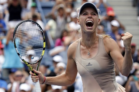 Wozniacki Outlasts Sharapova on Steamy Sunday