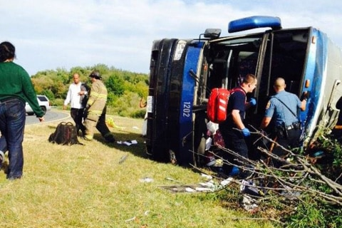 Tour Bus Overturns, Killing Two and Injuring Dozens