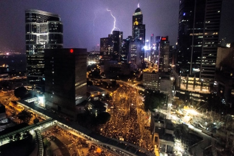 Protesters Defiant as Lightning Strikes Hong Kong