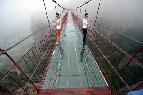 Tourists Tiptoe Across Transparent Bridge in China