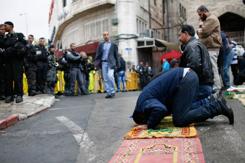 Muslims Pray in Rain After Israel Closes Al-Aqsa Mosque