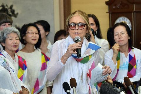 Gloria Steinem, Activists Cross DMZ Dividing Koreas by Bus