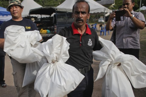 Malaysian Human Traffickers' Camps Had 139 Suspected Graves