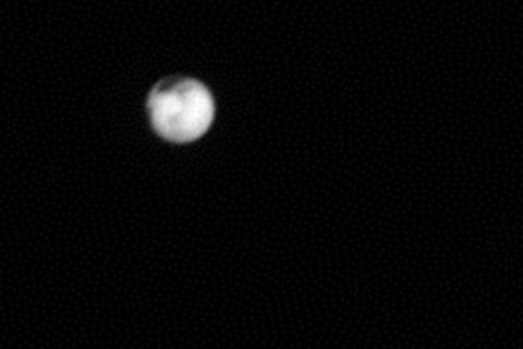Pluto's Dark Patch and Charon's Dark Pole Grow in New Horizons View