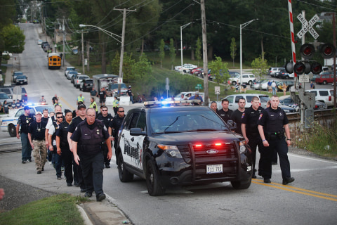Illinois Honors Slain Police Officer at Emotional Vigil