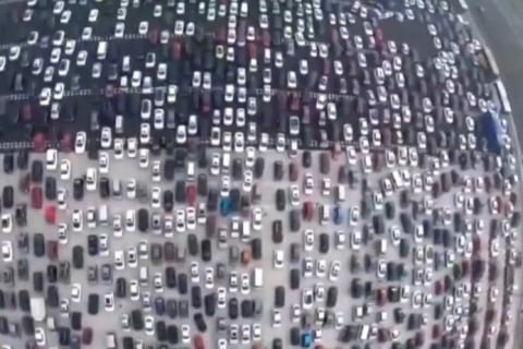 Think Your Commute Is Bad? Try 50 Lanes of Beijing Traffic