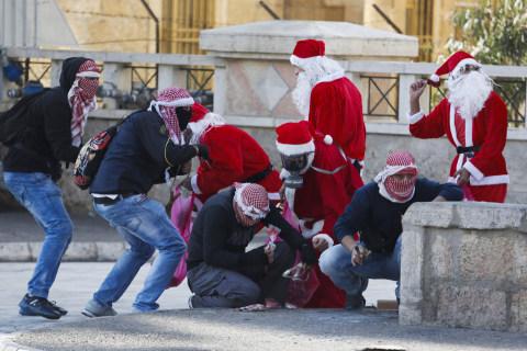 Palestinian Santas Clash With Israeli Soldiers
