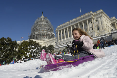 Sunday in Pictures: East Coast Snow Day and More