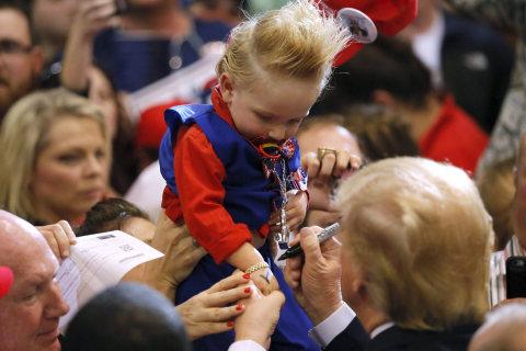 Donald Trump Autographs a Child in Baton Rouge
