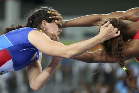 Olympic Moments: Athletes Go Head to Head for Chance at Victory
