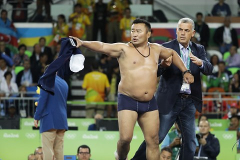 Mongolian Wrestling Coaches Protest Loss by Stripping Down