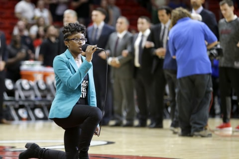Anthem Singer at NBA Preseason Game Kneels During Performance