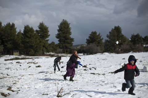 Today in Pictures: Refugee Snowball Fight in Greece and More