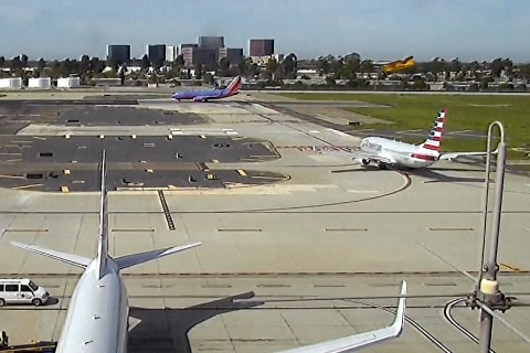 Video Shows Harrison Ford Fly Over Airliner at California Airport