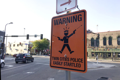Signs Mocking Police Appear in Minneapolis After Fatal Shooting of Australian Woman