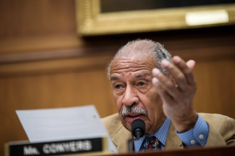 Conyers admits financial settlement with former staffer but denies misconduct