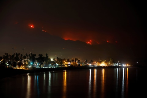 California coast battles massive wildfire