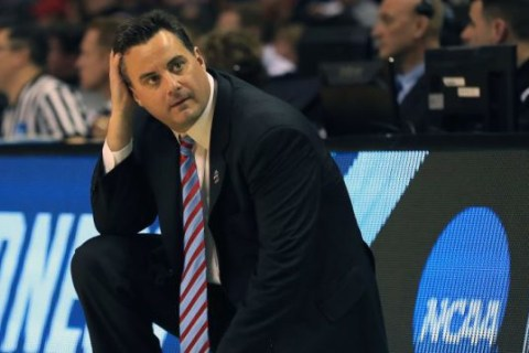 Arizona's Miller not coaching after reportedly discussing paying recruit on wiretap