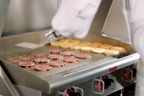 Watch Flippy the burger-flipping robot grab a spatula and get going