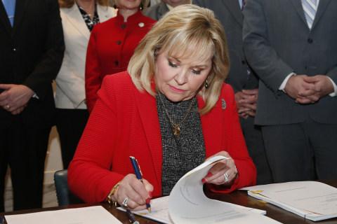 Oklahoma governor vetoes gun bill, signs adoption bill angering gun and gay rights groups