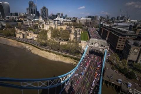 Paralyzed man walks London Marathon in 36 hours wearing exoskeleton suit