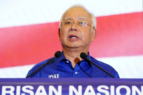 Malaysia bars ousted, scandal-plagued leader from leaving country